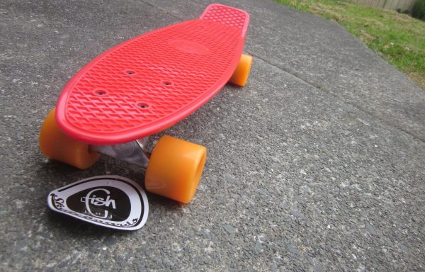 Red board with orange wheels