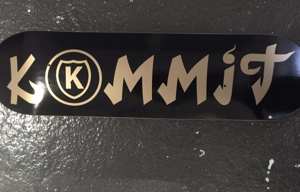 Kommit 7.75 inch black deck gold lettering