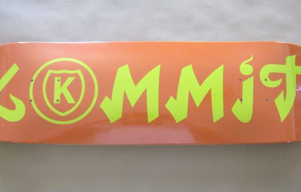 Kommit 8.50 inch orange deck yellow lettering